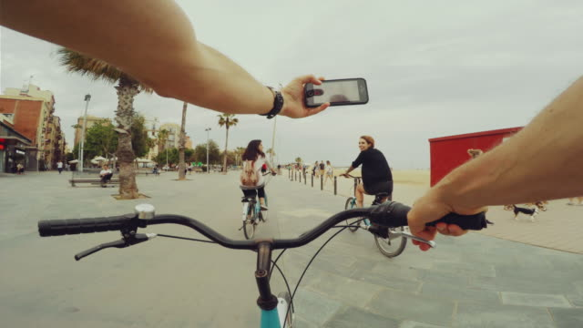 pov bicycle riding with two nice girls - filming stock videos & royalty-free footage