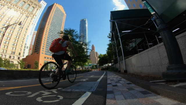 pov bicycle riding: woman with bike in new york - motorcycle biker stock videos & royalty-free footage