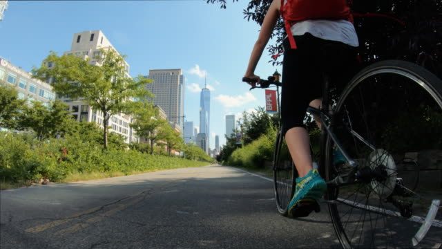 pov bicycle riding: woman with road bike in new york - motorcycle biker stock videos & royalty-free footage