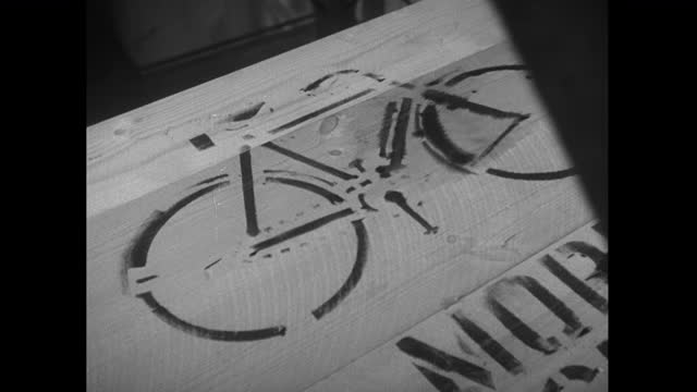 bicycle stencilled onto the side of wooden packing crate; 1952 - 1952 stock videos & royalty-free footage
