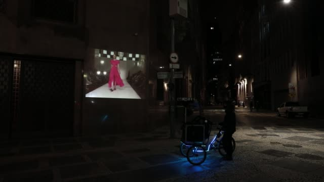 bicycle with a projection system projects photos on a wall in celebration of 25 years of sao paulo fashion week in downtown on november 4, 2020 in... - social history stock videos & royalty-free footage