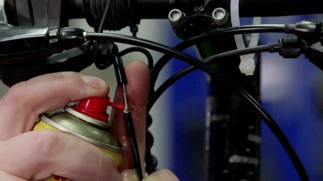 bicycle workshop - spraying brake line - repairing stock videos & royalty-free footage