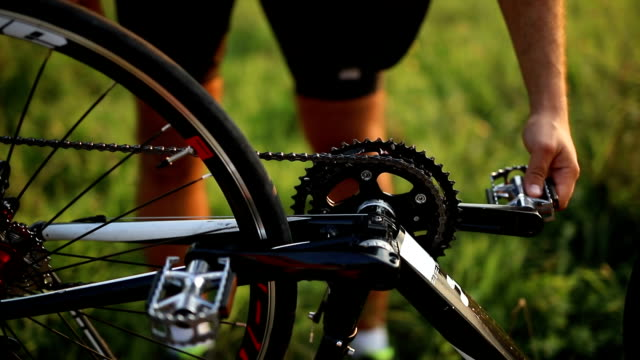 bicycler serviced bikes in field - pedal stock videos & royalty-free footage
