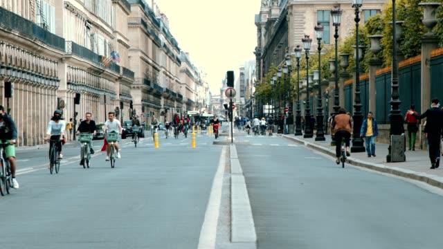 bicycles and pedestrians on rue de rivoli in paris, france - pedestrian video stock e b–roll