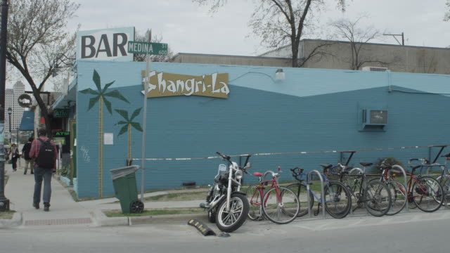 Bicycles chained along side of bar in Austin's East Sixth IBIZ District