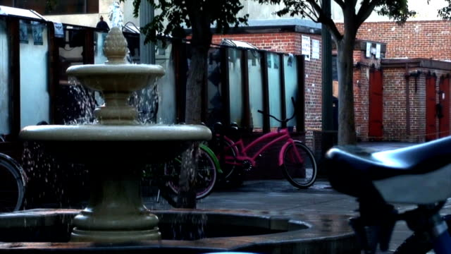 bicycles locked by a water fountain close up - huntington beach california stock videos and b-roll footage