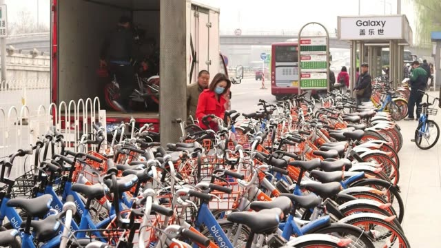 bicycles rented using smartphones bicycles rented using smartphones china beijing ext people crossing street many pushing bicycles various of long... - pushing stock videos & royalty-free footage