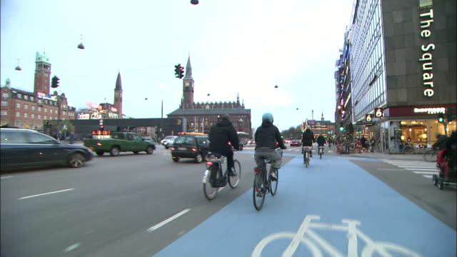 Bicyclists move with traffic through downtown Copenhagen.