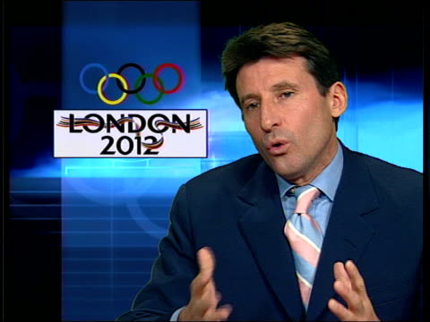 vídeos de stock, filmes e b-roll de bid book delivered to ioc headquarters; itn lord coe interview sot - it's an election/ elections are a complicated process/ all the cities left on... - sebastian coe