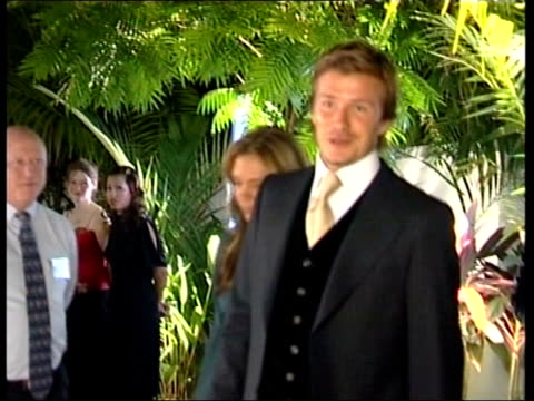 bid team in singapore for last days of campaigning ext / night lms david beckham and his wife victoria beckham walk along in evening dress to olympic... - 2005 stock videos and b-roll footage