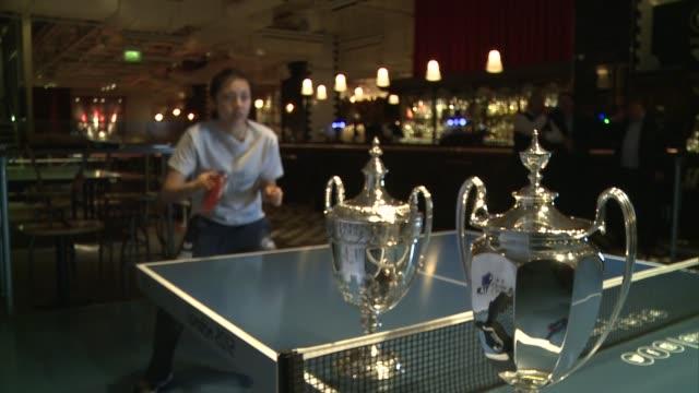 vídeos de stock, filmes e b-roll de bid to host major championship in the uk; england: london: ext various shots tin tin ho along road and into 'bounce' table tennis club int tin tin ho... - major road