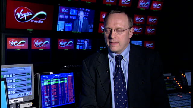 bidding war for virgin media cable tv operator england london int mike cansfield interview sot - cable tv stock videos and b-roll footage