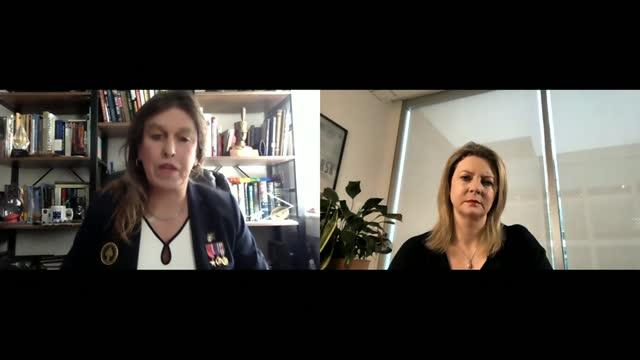 vídeos y material grabado en eventos de stock de biden executive order overturns trump ban on transgender military members; england: int kristin beck setup shots and interview via internet sot - politics