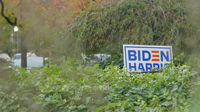 biden harris sign in front yard with greenery baltimore maryland - focus on background stock videos & royalty-free footage