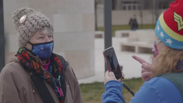 biden supporters chat on independence avenue at the u.s. capitol on inauguration day on january 21, 2021 in washington, dc. joe biden was sworn in as... - over the shoulder stock videos & royalty-free footage
