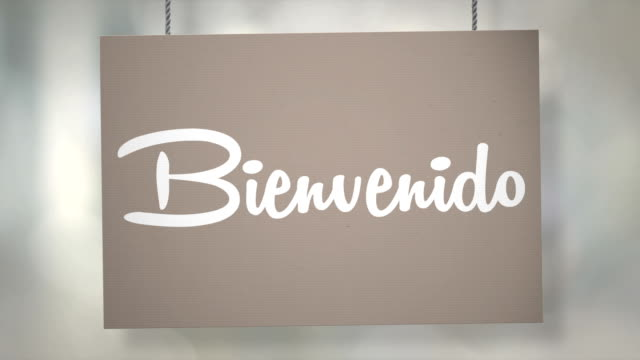 Bienvenido sign hanging from ropes. Luma matte included so you can put your own background.