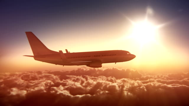 big airliner above the clouds - side view stock videos & royalty-free footage