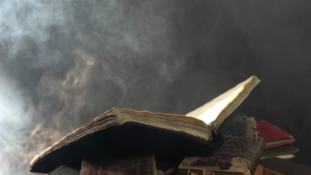 big antique book on top of stack of books - hardcover book stock videos and b-roll footage