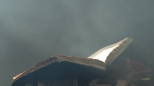 Big Antique Book On Top Of Stack Of books