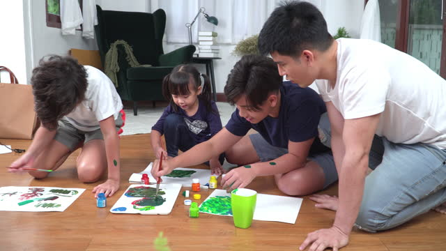 big asian brother, little brother, younger sister having hobbies weekend activities, watercolor paints paint together on the floor in the living room.  concept of city life, learning, sibling with simple living. - 12 13 years stock videos & royalty-free footage
