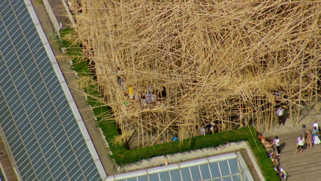 WS AERIAL Big Bambu art installation by Doug Starn and Mike Starn on roof of Metropolitan Museum of Art and pull out to entire roof top / New York, United States
