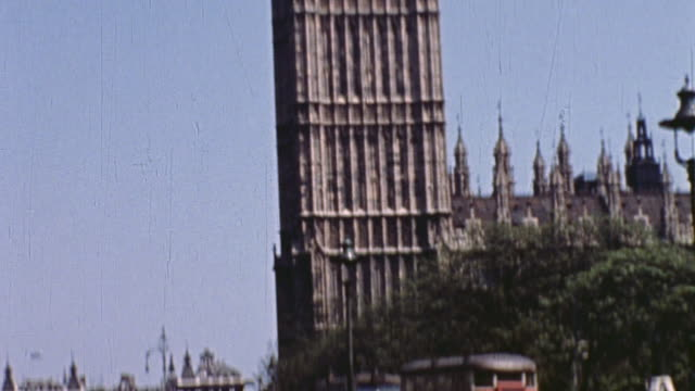 big ben and westminster abbey, with soldiers entering the church and traffic on the streets / london, england, united kingdom - houses of parliament london stock videos & royalty-free footage