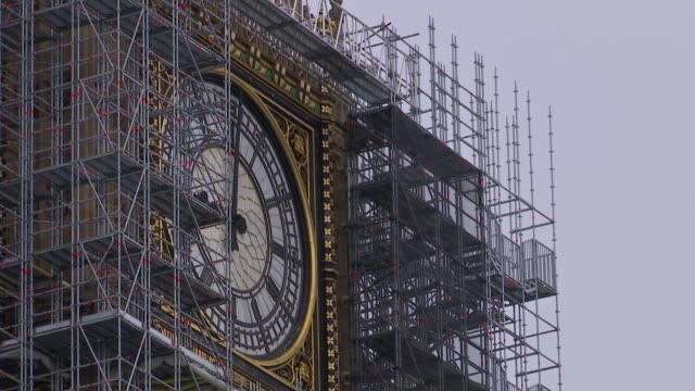 Big Ben chimes reconnected for Armistice day ENGLAND London Westminster EXT Various shots of Big Ben covered in scaffolding / Remembrance Day poppy...