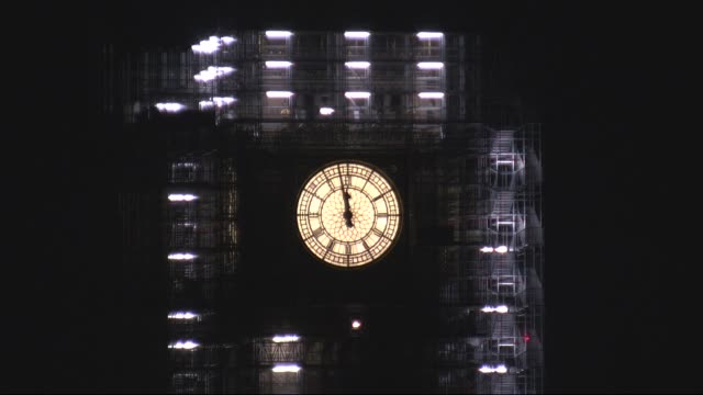 big ben clock at midnight during 2018 new year celebrations in london england london westminster big ben with scaffolding on clock tower and clock... - scaffolding stock videos & royalty-free footage