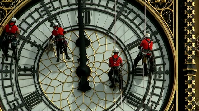 London Westminster EXT Great clock face as strikes 10 o'clock am NATSOT Abseilers waiting on balcony above the clock SHOT of minute hand moving...