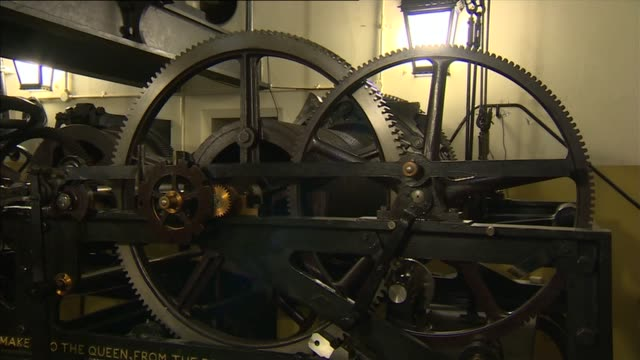 general views of bell and clock mechanism; england: london: westminster: int bell of big ben chiming sot / plaque ' fixed here 1859' / various shots... - machine part stock-videos und b-roll-filmmaterial