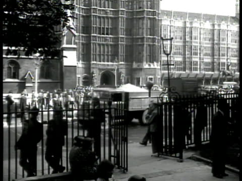 big ben clock tower london vs english on streets ws recruits entering building sailor guard int ws recruits getting clothes from counter wwii - 1930 1939 video stock e b–roll