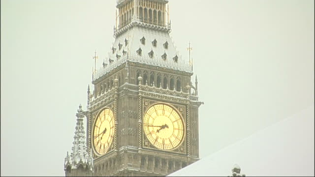 big ben clock tower marks 150th anniversary big ben clock tower covered in snow big ben and houses of parliament surrounded by snow - big ben stock videos & royalty-free footage