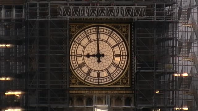 London EXT Locked off shot of clock face of Big Ben as chimes strike 9 o'clock SOT