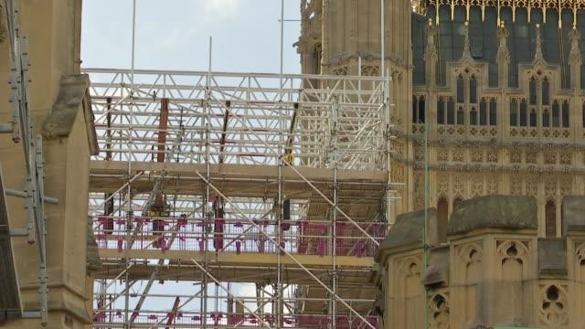 stockvideo's en b-roll-footage met big ben restoration general views england london westminster westminster palace big ben clock face / gvs westminster palace / general views... - steiger bouwapparatuur