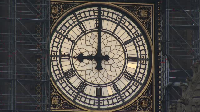 Big Ben strikes again for Christmas ENGLAND London Westminster EXT Close shot of clock face of Big Ben as chimes strike 9 o'clock SOT Various views...