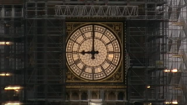 Big Ben strikes again for Christmas ENGLAND London Westminster Houses of Parliament EXT **Big Ben head tolling 9 AM Clock face on Big Ben clock tower...