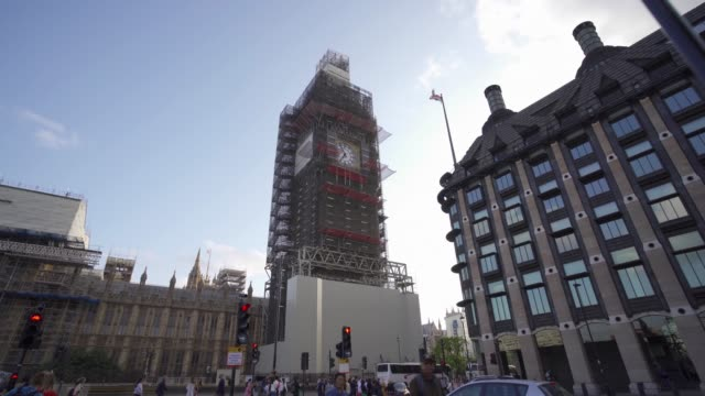 big ben under repair and houses of parliament, london, england, united kingdom, europe - big ben点の映像素材/bロール