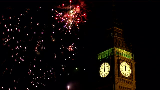big ben with fireworks behind - london - big ben stock videos & royalty-free footage