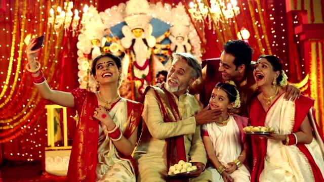 Big bengali family celebrating durga puja festival, Delhi, India