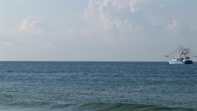 A big boat on the blue sea.