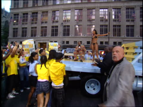Big Boi arriving at the 2003 VMAs on a flatbed truck with a stripper pole surrounded by kids with signs