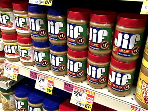 vídeos y material grabado en eventos de stock de store big brands like jif skippy and peter pan are raising their prices due to a hot and dry summer that devastated the peanut crop of 2011 according... - kraft