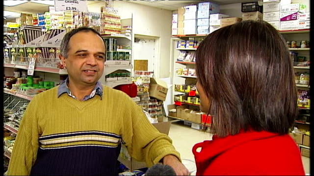 vídeos de stock, filmes e b-roll de 'big brother' programme racist bullying claims debate continues / sponsor pulls out leicester vox pop asian shopkeeper ext traffic reflected in shop... - big brother