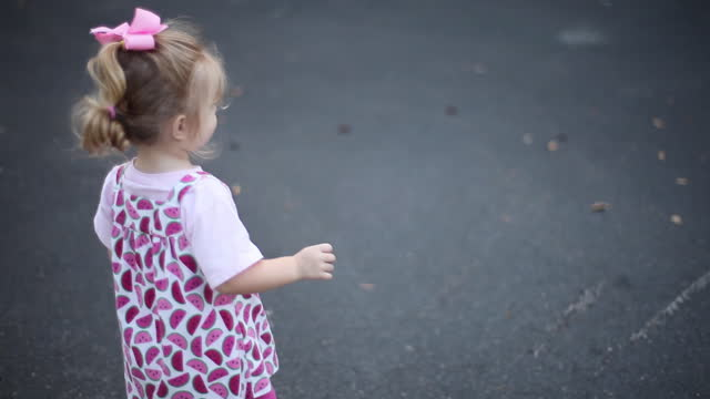 a big brother supervises his toddler sister in their driveway. - driveway stock videos & royalty-free footage