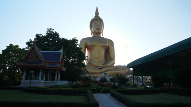 big buddha at wat muang temple. it is the biggest buddha statue in thailand - buddha stock videos & royalty-free footage