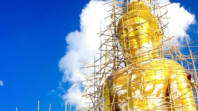 Big buddha statue under restoration, timelapse