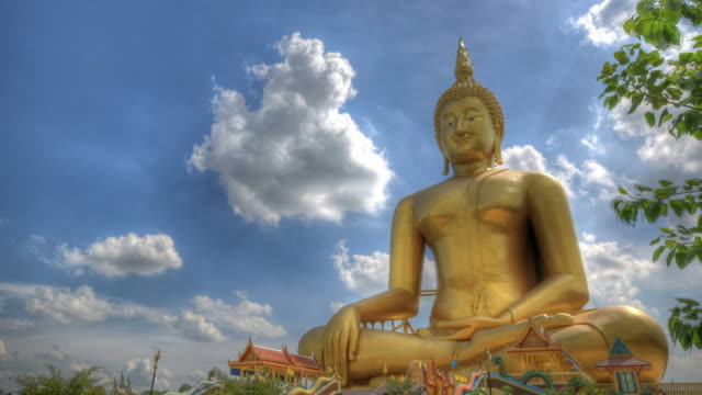 Big Buddha statue with cloud motion