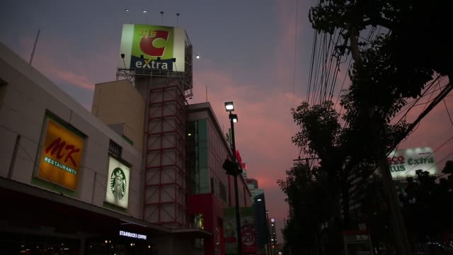 big c supercenter pcl signage is displayed outside an outlet at dusk, in bangkok, thailand, on tuesday, feb 9 a big c supercenter pcl signage stands... - ナイトイン点の映像素材/bロール