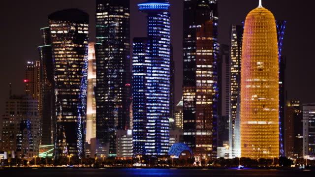 big city skylines at night. coastline - qatar stock videos & royalty-free footage