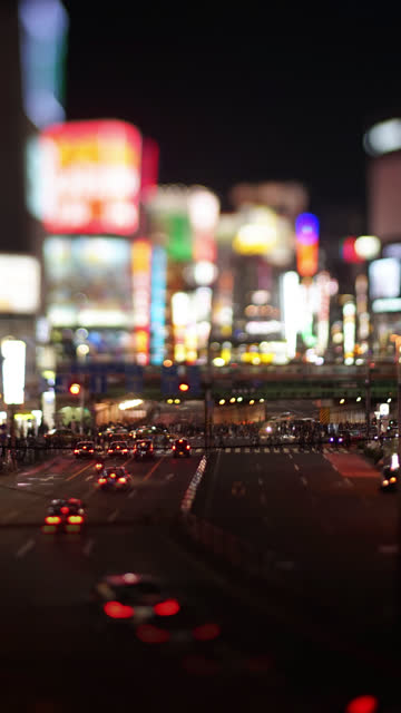 Big City Traffic and Neon Lights at Night (Tilt-Shift/Time Lapse)